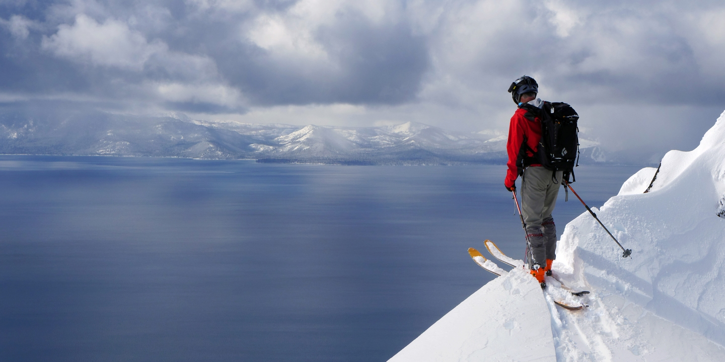 Jeff Glass, backcountry enthusiast and cat lover, contemplating the descent to the shores of Lake Tahoe.