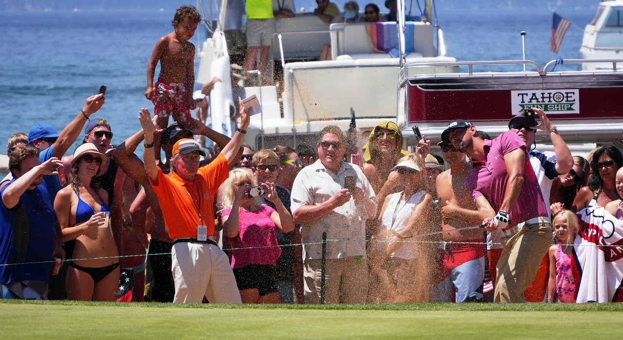 Michael Phelps, Olympic gold medalist, blasting out of the beach at Edgewood Tahoe during the American Century Celebrity Championship.